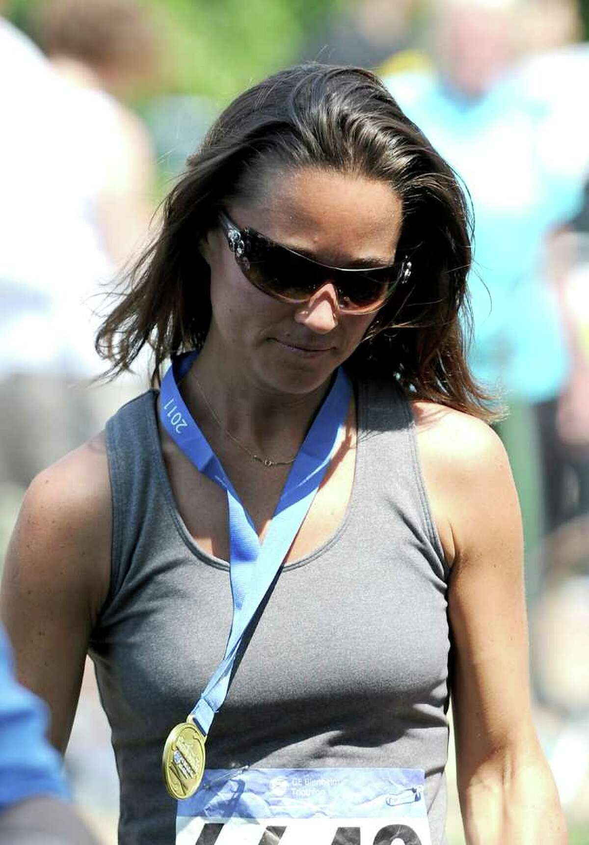 WOODSTOCK, ENGLAND - JUNE 04: Pippa Middleton looks on after collecting her finisher's medal during the GE Blenheim Triathlon at Blenheim Palace on June 4, 2011 in Woodstock, England. (Photo by Chris Brunskill/Getty Images)