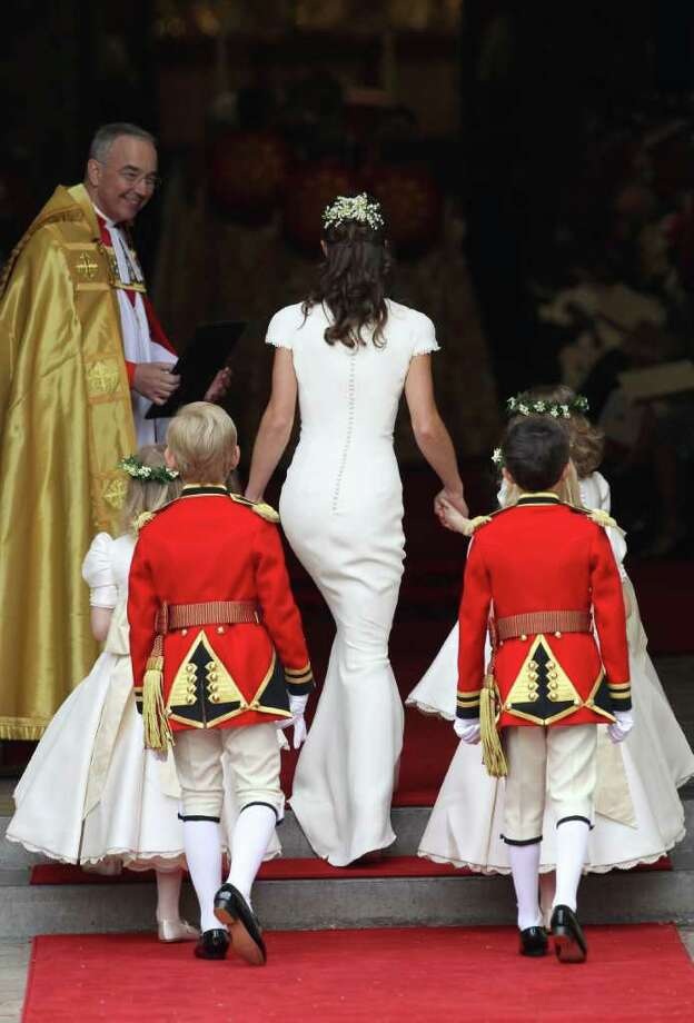LONDON, ENGLAND - APRIL 29:  Maid of Honour Pippa Middleton with pageboys and bridemaids is greeted by The Very Reverend Dr John Hall (L), Dean of Westminster as they arrive to attend the Royal Wedding of Prince William to Catherine Middleton at Westminster Abbey on April 29, 2011 in London, England. The marriage of the second in line to the British throne is to be led by the Archbishop of Canterbury and will be attended by 1900 guests, including foreign Royal family members and heads of state. Thousands of well-wishers from around the world have also flocked to London to witness the spectacle and pageantry of the Royal Wedding.  (Photo by Chris Jackson/Getty Images) *** Local Caption *** Dr John Hall;Pippa Middleton; Photo: Getty Images