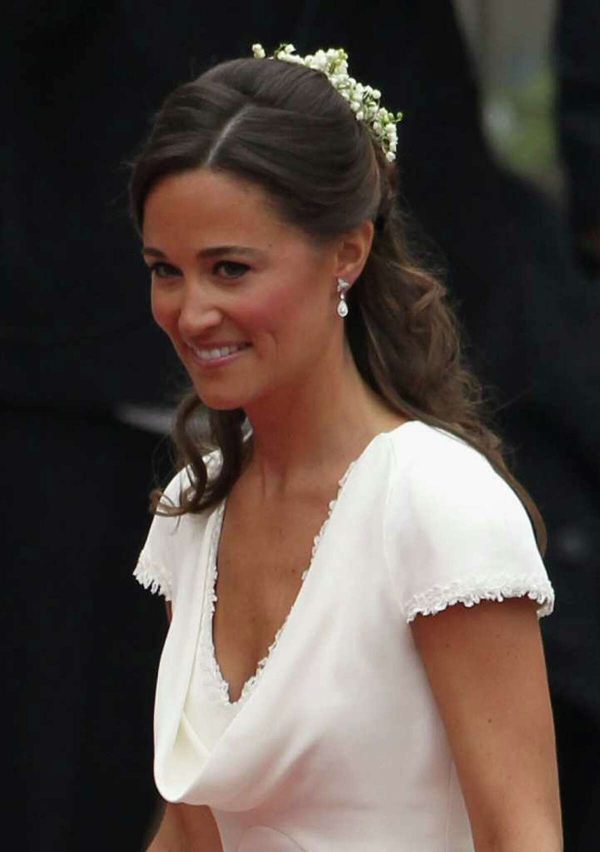 LONDON, ENGLAND - APRIL 29: Sister of the bride and Maid of Honour Pippa Middleton arrives to attend the Royal Wedding of Prince William to Catherine Middleton at Westminster Abbey on April 29, 2011 in London, England. The marriage of the second in line to the British throne is to be led by the Archbishop of Canterbury and will be attended by 1900 guests, including foreign Royal family members and heads of state. Thousands of well-wishers from around the world have also flocked to London to witness the spectacle and pageantry of the Royal Wedding. (Photo by Dan Kitwood/Getty Images) *** Local Caption *** Pippa Middleton;