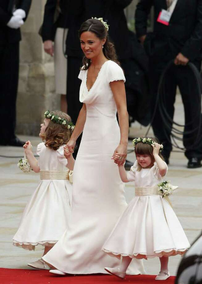 LONDON, ENGLAND - APRIL 29:  Sister of the bride and Maid of Honour Pippa Middleton (C) holds hands with Grace Van Cutsem (L) and Eliza Lopes as they arrive to attend the Royal Wedding of Prince William to Catherine Middleton at Westminster Abbey on April 29, 2011 in London, England. The marriage of the second in line to the British throne is to be led by the Archbishop of Canterbury and will be attended by 1900 guests, including foreign Royal family members and heads of state. Thousands of well-wishers from around the world have also flocked to London to witness the spectacle and pageantry of the Royal Wedding.  (Photo by Dan Kitwood/Getty Images) *** Local Caption *** Pippa Middleton;Grace Van Cutsem;Eliza Lopes; Photo: Getty Images