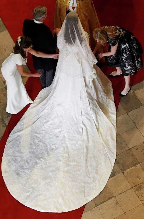 LONDON, ENGLAND - APRIL 29:  Catherine Middleton has her dress adjusted by her sister and Maid of Honor Pippa Middleton as she arrives with her father Michael Middleton before her wedding at Westminster Abbey ahead of the Royal Wedding of Prince William to Catherine Middleton at Westminster Abbey on April 29, 2011 in London, England. The marriage of the second in line to the British throne is to be led by the Archbishop of Canterbury and will be attended by 1900 guests, including foreign Royal family members and heads of state. Thousands of well-wishers from around the world have also flocked to London to witness the spectacle and pageantry of the Royal Wedding. (Photo by Suzanne Plunkett - WPA Pool/Getty Images) *** Local Caption *** Pippa Middleton;Michael Middleton;Catherine Middleton; Photo: Getty Images