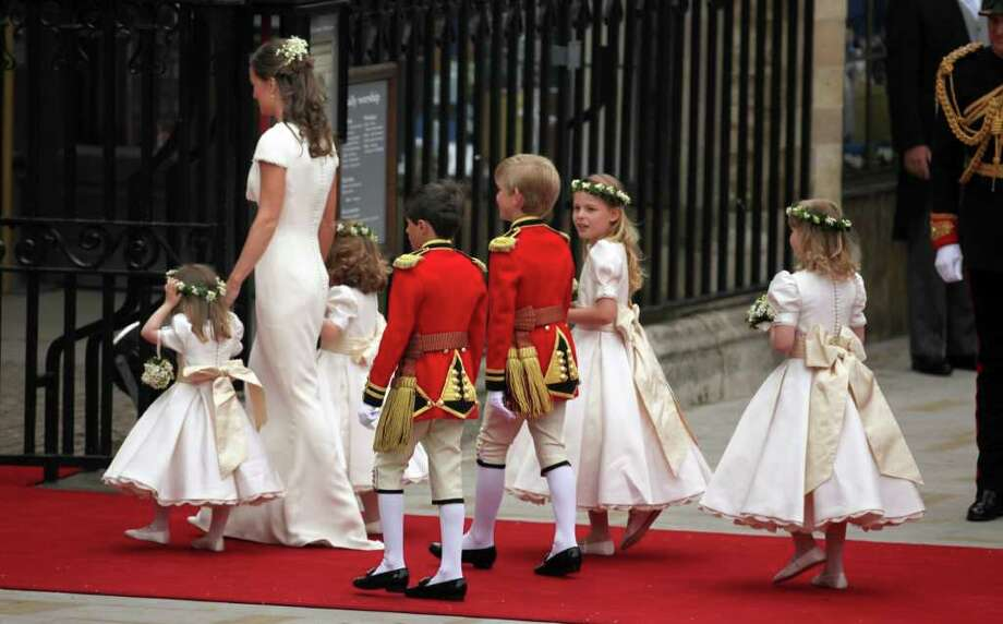 LONDON, ENGLAND - APRIL 29: Pippa Middleton, sister of the bride arrives with the flower girls and page boys at Westmister Abbey on April 29, 2011 in London, England.  The marriage of Prince William, the second in line to the British throne, to Catherine Middleton is being held in London today. The Archbishop of Canterbury conducted the service which was attended by 1900 guests, including foreign Royal family members and heads of state. Thousands of well-wishers from around the world have also flocked to London to witness the spectacle and pageantry of the Royal Wedding and street parties are being held throughout the UK. (Photo by Paul Rogers - WPA Pool/Getty Images) *** Local Caption *** Pippa Middleton; Photo: Getty Images