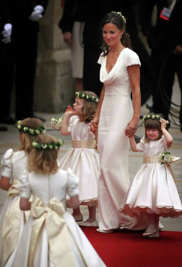 LONDON, ENGLAND - APRIL 29: Pippa Middleton arrives with the brides maids and page boys at Westminster Abbey for the Royal Wedding of Prince William to Catherine Middleton at Westminster Abbey on April 29, 2011 in London, England. The marriage of the second in line to the British throne is to be led by the Archbishop of Canterbury and will be attended by 1900 guests, including foreign Royal family members and heads of state. Thousands of well-wishers from around the world have also flocked to London to witness the spectacle and pageantry of the Royal Wedding.  (Photo by Paul Rogers - WPA Pool/Getty Images) *** Local Caption *** Pippa Middleton; Photo: Getty Images
