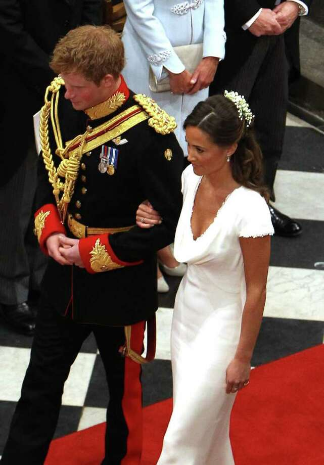LONDON, UNITED KINGDOM - APRIL 29:  Prince Harry and Maid of Honour Pippa Middleton walk down the aisle at Westminster Abbey following the wedding ceremony of Prince William, Duke of Cambridge and Catherine, Duchess of Cambridge on April 29, 2011 in London England. The marriage of the second in line to the British throne was led by the Archbishop of Canterbury and was attended by 1900 guests, including foreign Royal family members and heads of state. Thousands of well-wishers from around the world have also flocked to London to witness the spectacle and pageantry of the Royal Wedding. (Photo by Clara Molden - WPA Pool/Getty Images) *** Local Caption *** Maid of Honour Pippa Middleton;Prince Harry; Photo: Getty Images