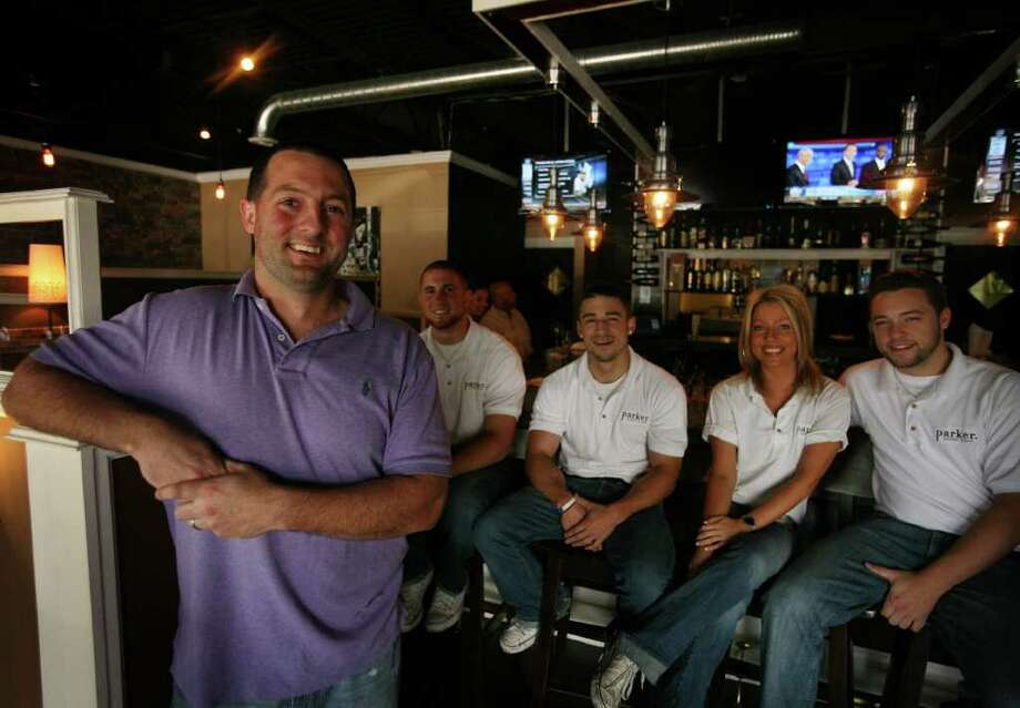 From left; Owner Pat Fahy, Jon Jones, Brett Hirschbeck, Jen Lindsay, and Brandon McNeil at Parker Eatery and Bar at 7365 Main Street in Stratford. Photo: Brian A. Pounds / Connecticut Post