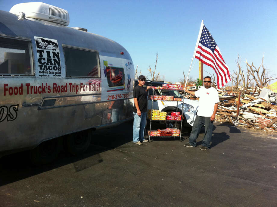 Food truck owners Manny Olivarez (left) and neil Hajji deliver relief meals to tornado victims in Joplin, Mo.