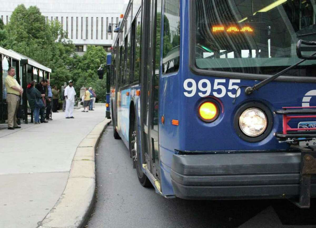 A bus pulls up to a downtown Albany bus stop on Monday, June 13, 2011. (Erin Colligan / Special To The Times Union)