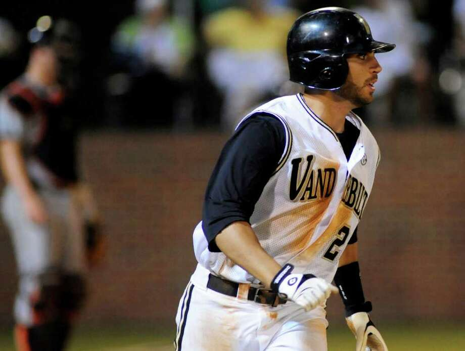 Vanderbilt's Jason Esposito watches his 2-run homer leave the ballpark against Oregon St. in the sixth inning of Game 1 of an NCAA Super Regionals college baseball tournament  on Friday, June 10, 2011, in Nashville, Tenn. Vanderbilt won the game 11-1. (AP Photo/Mike Strasinger) Photo: AP
