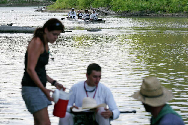 Competitors approach the FM 766 checkpoint on the Guadalupe River in Cheapside on Sunday, June 12 during the 2011 Texas Water Safari. The race is 260-miles from San Marcos to Seadrift. Photo: Edward A. Ornelas/eaornelas@express-news.net / eaornelas@express-news.net