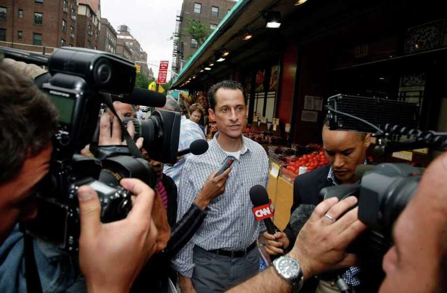 Rep. Anthony Weiner, D-N.Y., is questioned by the media near his home in the Queens borough of New York, Saturday, June  11, 2011. The 46-year-old congressman acknowledged Friday that he had online contact with a 17-year-old girl from Delaware but said there was nothing inappropriate. (AP Photo/David Karp) Photo: DAVID KARP