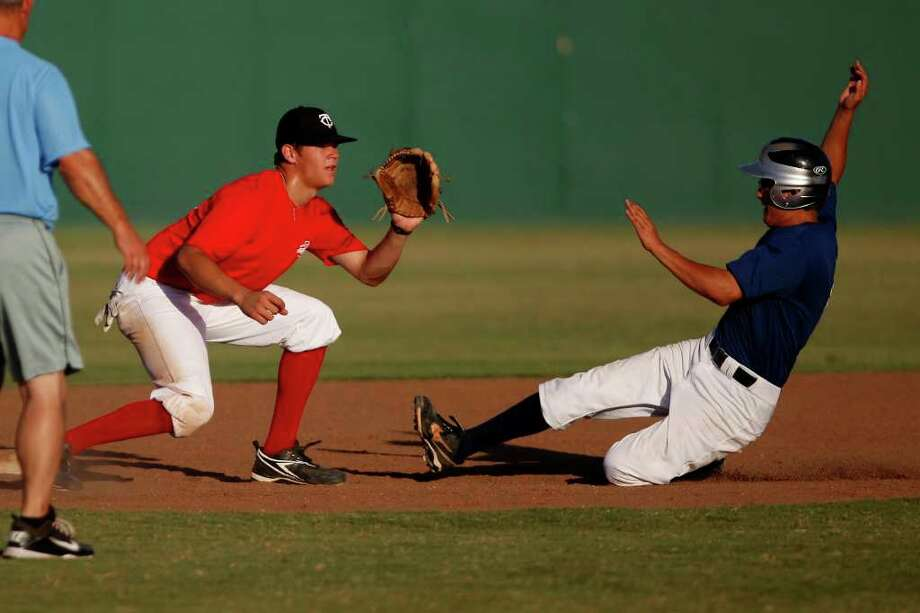Burbank's Gabe Raygoza (right) slides in to steal second base for the Senior team while Clark's Chad Dullnig defends second for the Junior team during the San Antonio High School All-Star Game at San Antonio's North East Stadium on Tuesday, June 14, 2011. Photo: Lisa Krantz/lkrantz@express-news.net / SAN ANTONIO EXPRESS-NEWS
