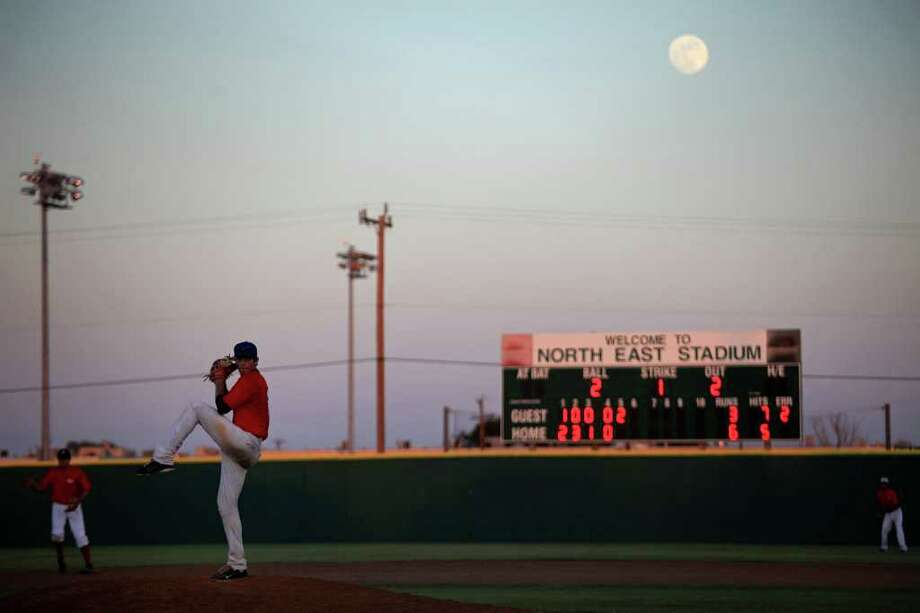 Madison's Tyler Gonzales pitches for the Junior team as the moon rises during the San Antonio High School All-Star Game at San Antonio's North East Stadium on Tuesday, June 14, 2011. Photo: Lisa Krantz/lkrantz@express-news.net / SAN ANTONIO EXPRESS-NEWS