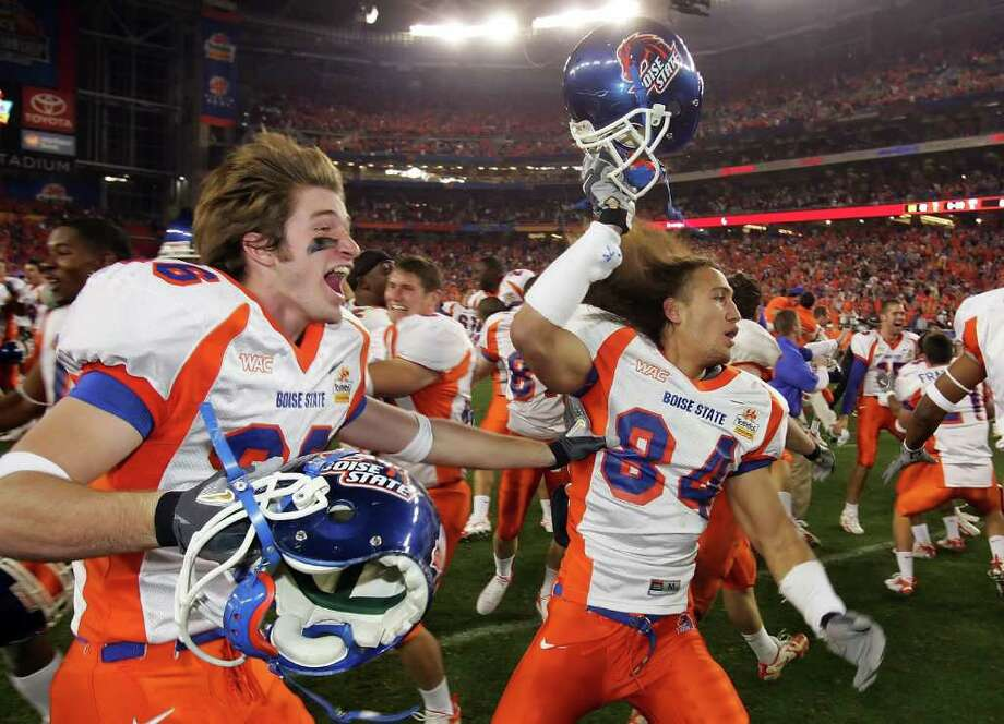 Boise State's Seth Anderson (left) and Aiona Key celebrate a 43-42 win over the Oklahoma Sooners at the Fiesta Bowl in 2007. The Broncos have played in the Fiesta Bowl twice in the last five years. Photo: Jonathan Ferrey/Getty Images / 2007 Getty Images