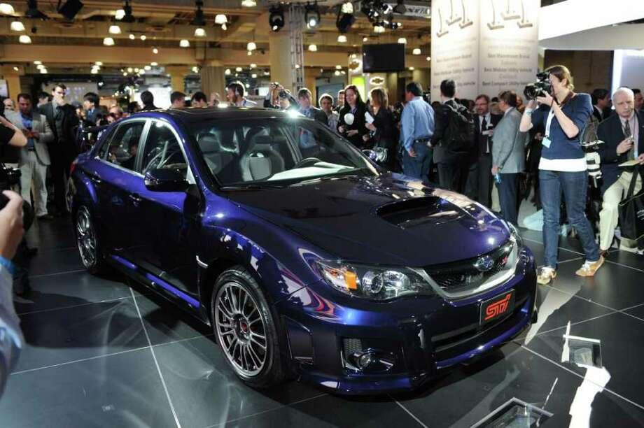 Model: 2013 Subaru Impreza WRX STiSpeed: 5.4 secondsStarting price: $35,000Source: Consumer Reports Photo: STAN HONDA, AFP/Getty Images / 2010 AFP
