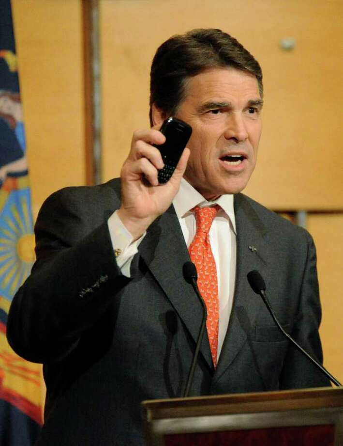 """Texas Governor Rick Perry speaks at the Lincoln Dinner, an annual fundraising event for the New York GOP, Tuesday, June 14, 2011 in New York. Perry stirred speculation Tuesday that he would seek the 2012 Republican presidential nomination, telling a television interviewer he would engage in a """"thought process"""" before deciding whether to join the field. Photo: AP"""