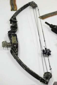 "A bow is pictured at a media presentation of a weapons cache that includes 154 rifles and shotguns and over 92,000 rounds of ammunition, in Mexico City, Friday June 3, 2011. Army Gen. Edgar Luis Villegas said Friday the weapons were found in ""a subterranean stockpile"" at a ranch near the northern city of Monclova this week.  Authorities believe the weapons belonged to the Zetas drug cartel. Photo: AP"