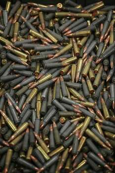 "7.62 mm cartridges are seen at a media presentation of a weapons cache that includes 154 rifles and shotguns and over 92,000 rounds of ammunition, in Mexico City, Friday June 3, 2011. Army Gen. Edgar Luis Villegas said Friday the weapons were found in ""a subterranean stockpile"" at a ranch near the northern city of Monclova this week.  Authorities believe the weapons belonged to the Zetas drug cartel. Photo: AP"