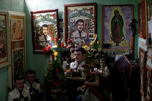 In this Tuesday, April 5, 2011 picture, images and busts of popular saint Jesus Malverde adorn a room inside the Jesus Malverde shrine in Culiacan, Mexico. The folk-saint is worshipped by many drug traffickers. The state of Sinaloa is known as the cradle of drug trafficking in the country. Photo: AP