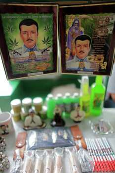 In this Tuesday, April 5, 2011 picture, items related to Jesus Malverde are displayed for sale outside of the Jesus Malverde shrine in Culiacan, Mexico. The folk-saint is worshipped by many drug traffickers. Sinaloa state is known as the cradle of drug trafficking in the country. Photo: AP