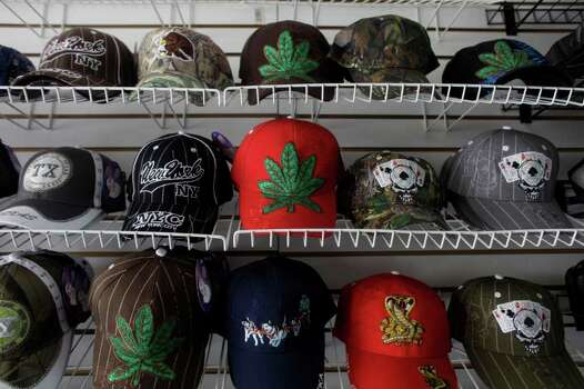 In this Tuesday, April 5, 2011 picture, baseball caps decorated with marijuana leaves, skulls and other symbols are displayed for sale in Culiacan, Sinaloa, Mexico. Signs of the illegal drug trade flourishes openly in Sinaloa state is known as the cradle of drug trafficking in the country. Photo: AP