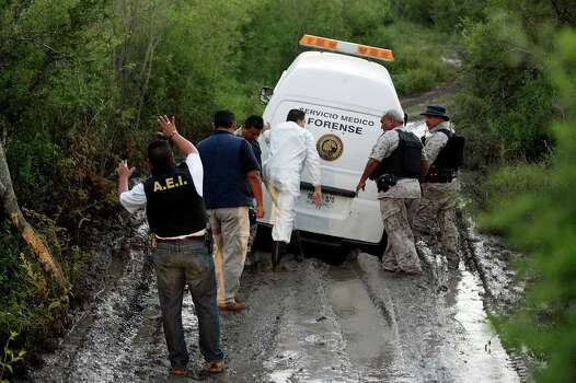 MEXICO -- A Nuevo Leon Forensic unit van gets stuck in mud as they while attempting to reach the scene of a confrontation between the Mexican army and alleged kidnappers at a ranch just west of Ceralvo, Mexico, Wednesday, Sept. 29, 2010. The army responded to a call of men holding kidnap victims at the ranch and a gunfight broke out when they arrived. Four of the kidnappers were killed and four of the victims were rescued. According to Gen. Cuauhtemoc Antunes, the victims were laborers from the Ceralvo area. JERRY LARA/glara@express-news.net Photo: JERRY LARA, San Antonio Express-News / glara@express-news.net