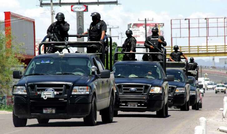 Police officers patrol a street in Torreon, in the Mexican northern state of Coahuila, Monday, July 19, 2010. Sunday gunmen interrupted a party in Torreon, killing 17 people and injuring at least 18 without saying a word, the Coahuila state Attorney General's Office said in statement.
