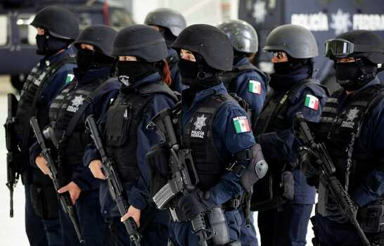Police officers stand in formation during a presentation of drug dealing suspects to the media in Mexico City, Tuesday, June 15, 2010. Photo: Eduardo Verdugo, AP / AP