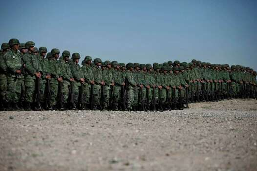 Soldiers stand in line during the burning of over 2 tons of seized marijuana and cocaine in Ciudad Juarez, Mexico, Thursday, March 18, 2010. Photo: Miguel Tovar, AP / AP