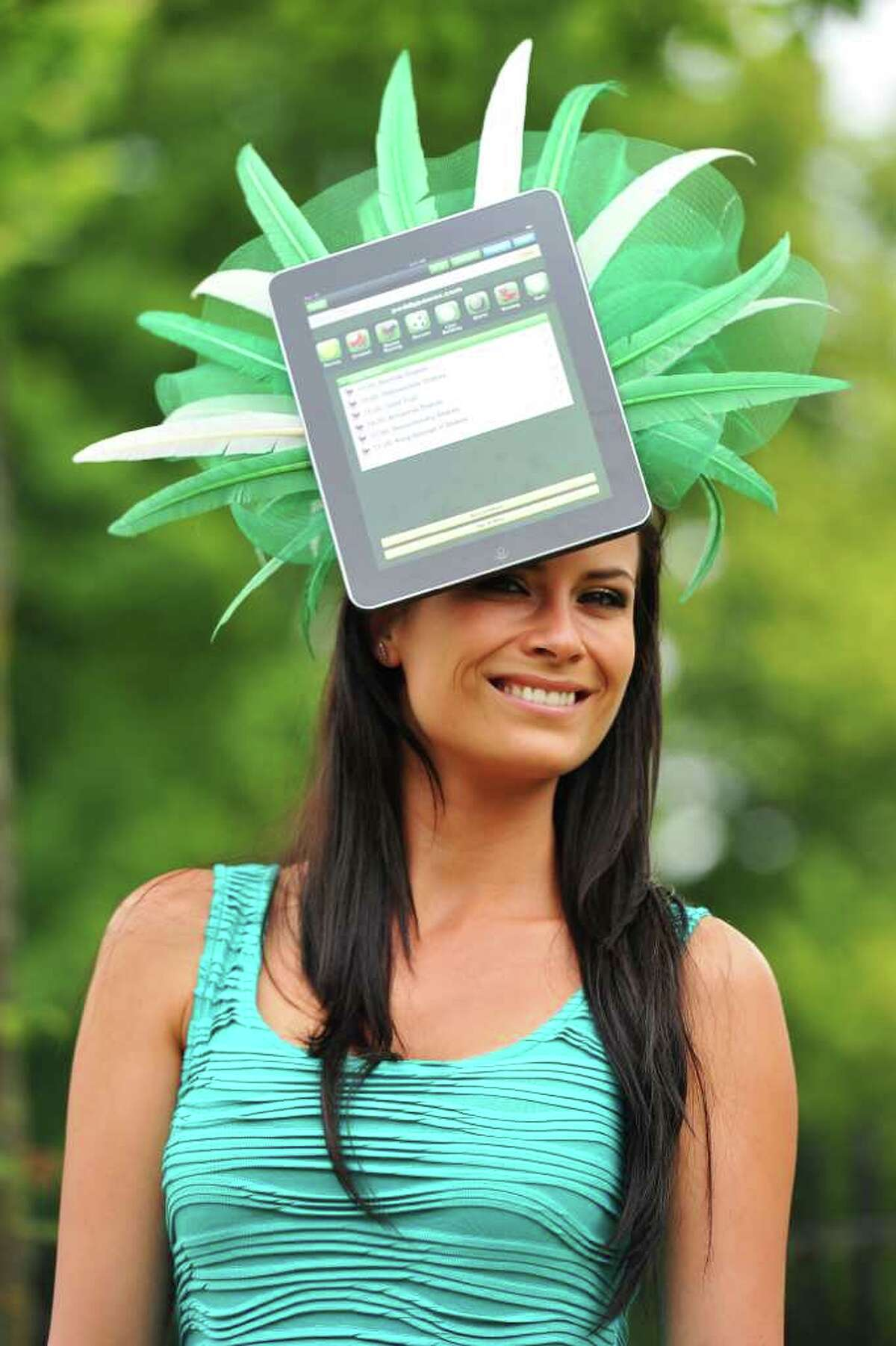 A race-goer wears a hat with an iPad design on the second day of the annual Royal Ascot horse racing event near Windsor, west of London, in Berkshire, on Wednesday. The five-day meeting is one of the highlights of the global horse racing calendar. Horse racing has been held at the famous Berkshire course since 1711 and tradition is a hallmark of the meeting. Top hats and tails remain compulsory in parts of the course while a daily procession of horse-drawn carriages brings the Queen to the course. AFP PHOTO/Carl de Souza
