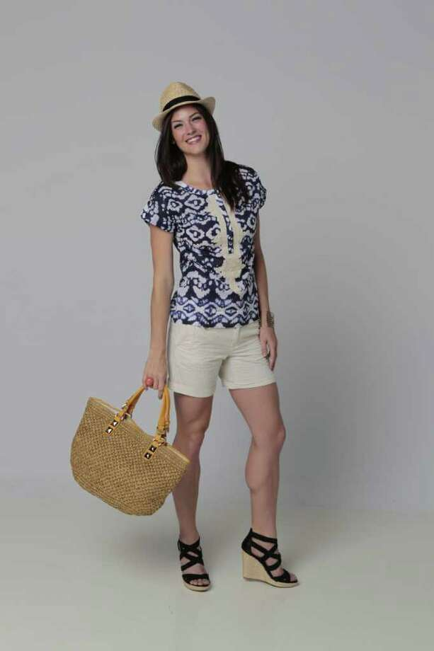 Hannah Taylor of Page Parkes Models is wearing tie-dye top, $41.65 (sale), seersucker shorts, $34.65 (sale), straw fedora, $45, bangle set, $25; all from Banana Republic. Her shoes are, Jessica Simpson Cactus Wedges, $79; and Michael Kors Straw Tote Bag, $238.40; both from Macy's. (Billy Smith II/ Houston Chronicle) Photo: Billy Smith II / 2011 Chronicle