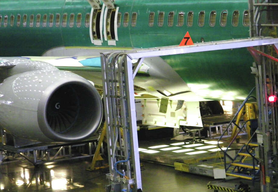 Boeing workers assemble a 737 on Friday, June 3, 2011 in Boeing's 737 plant in Renton, Wash. Photo: Aubrey Cohen/seattlepi.com