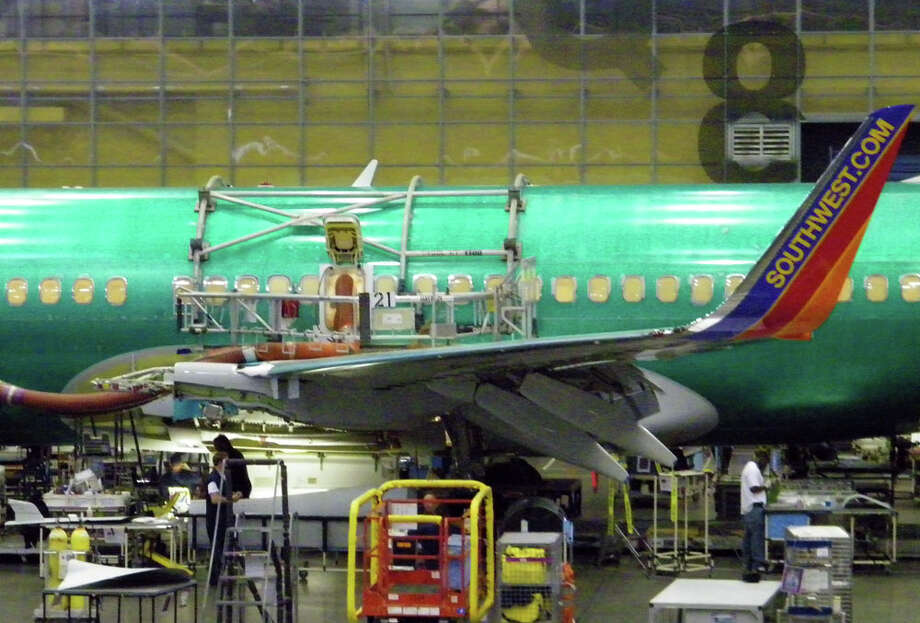 Boeing workers assemble a 737 for Southwest Airlines on Friday, June 3, 2011 in Boeing's 737 plant in Renton, Wash. Photo: Aubrey Cohen/seattlepi.com