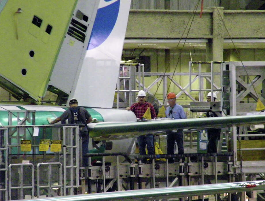 Boeing workers attach a horizontal stabilizer to a 737 on Friday, June 3, 2011 in Boeing's 737 plant in Renton, Wash. Photo: Aubrey Cohen/seattlepi.com