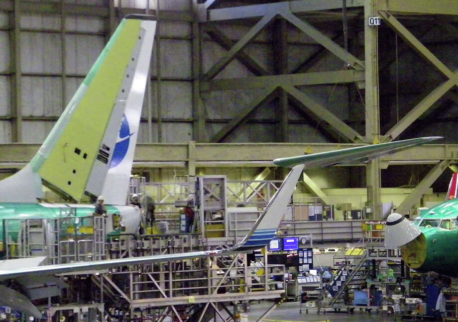 A crane moves a horizontal stabilizer into place on a 737 on Friday, June 3, 2011 in Boeing's 737 plant in Renton, Wash. Photo: Aubrey Cohen/seattlepi.com