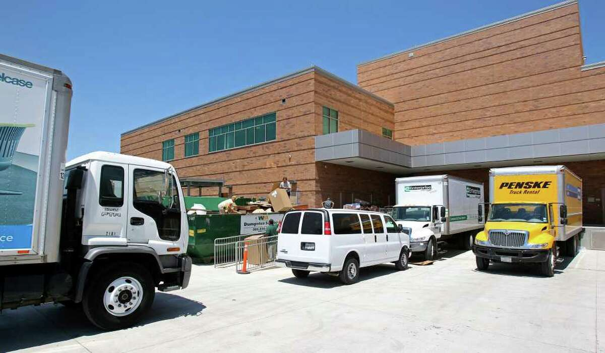 Delivery trucks clog up the back docks as Mission Trail Baptist Hospital gets ready to go into service this summer.