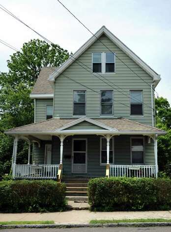 A two-family apartment at 41 Hubbell Ave. in Ansonia, Conn. was the home of a 5-month-old boy who was killed as the result of blunt force trauma to the head. Photo: Autumn Driscoll / Connecticut Post