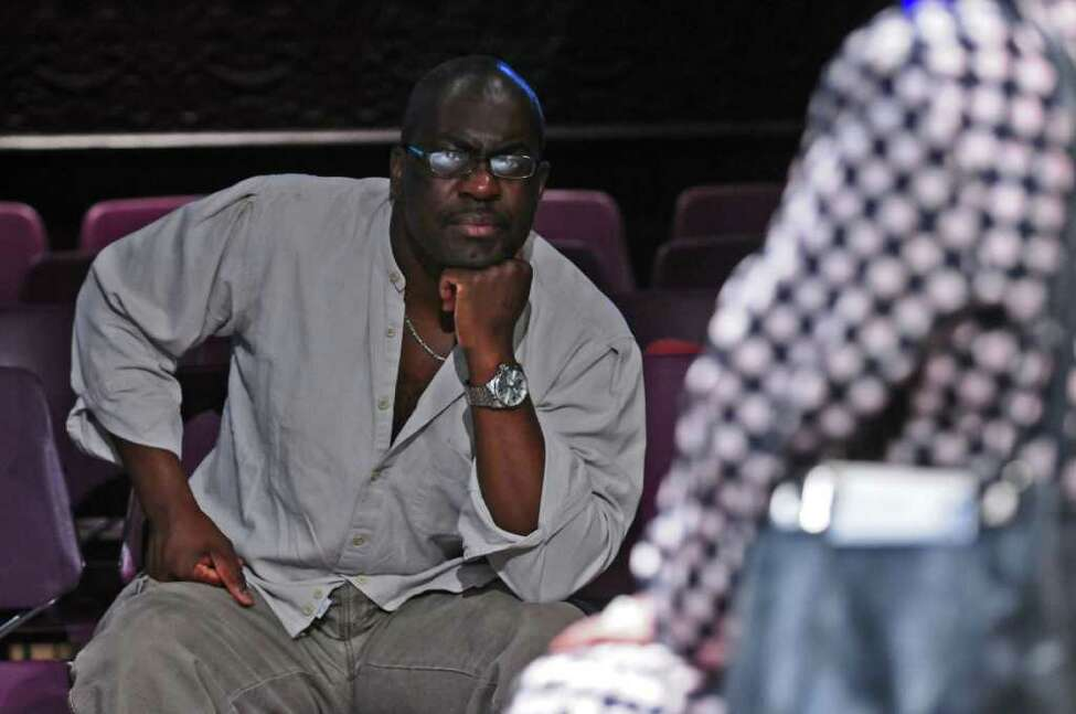 Jean-Remy Monnay, co-founder of the Soul Rebel Performance Troupe, watches as they prepare for