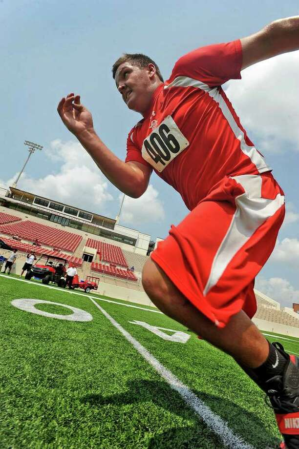 Deweyville's Daniel Brinson takes off into a sprint during Lamar's football camp on Thursday. Guiseppe Barranco/The Enterprise Photo: Guiseppe Barranco