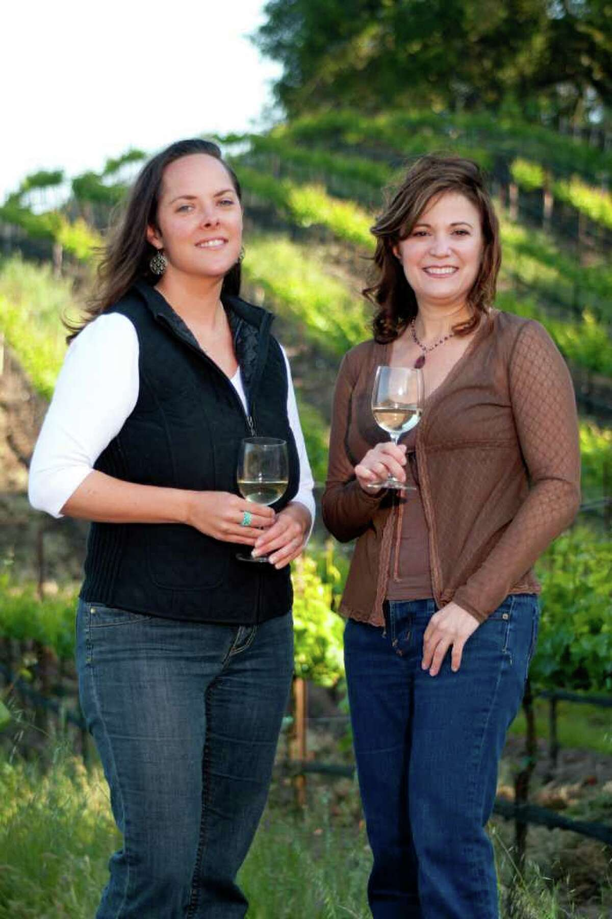 Deborah Brenner (right) who runs the Women of the Vine wine company tastes a new vintage from Sonoma County grower and wine maker Alison Crowe.