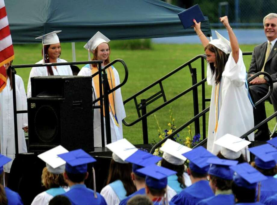 Graduate Emily Miko raises her arms in triumph after receiving her diploma, during Seymour High School's 124th Commencement in Seymour, Conn. on Wednesday June 15, 2011. Photo: Christian Abraham / Connecticut Post