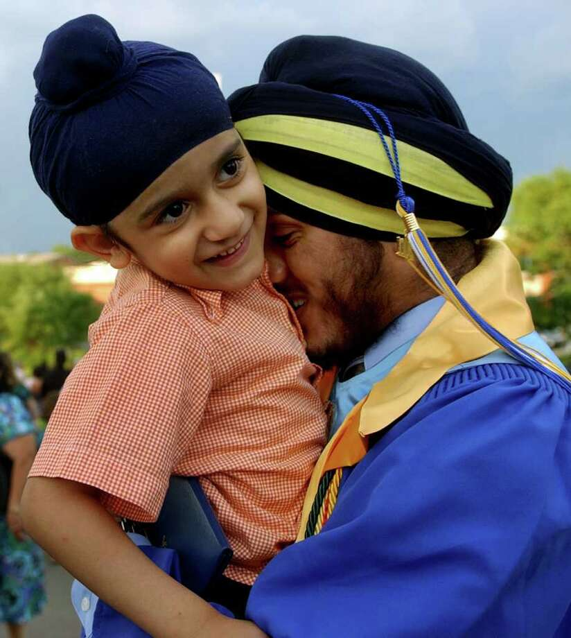 Graduate Bhupinder Singh hugs his cousin Uptej Singh after Seymour High School's 124th Commencement in Seymour, Conn. on Wednesday June 15, 2011. Photo: Christian Abraham / Connecticut Post
