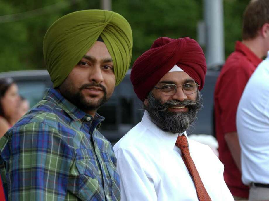 Highlights from Seymour High School's 124th Commencement in Seymour, Conn. on Wednesday June 15, 2011. Surinderpal Singh, left, and his brother Hargurpreet Singh. Hargurpreet was there to see his son Bhupinder Singh graduate. Surinderpal is Bhupinder's uncle. Photo: Christian Abraham / Connecticut Post