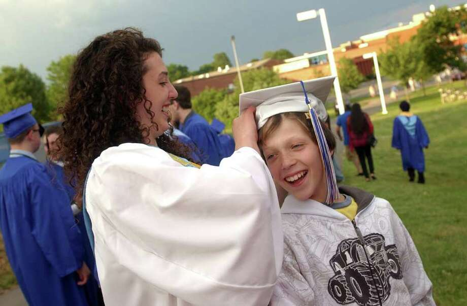 Highlights from Seymour High School's 124th Commencement in Seymour, Conn. on Wednesday June 15, 2011. Graduate Maggie Crocamo puts her cap on the head of her brother Jack, 9. Photo: Christian Abraham / Connecticut Post