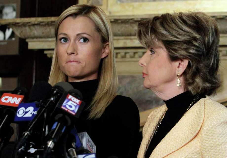Former porn actress Ginger Lee, left,  and her attorney Gloria Allred address a news conference at the Friars Club, in New York,  Wednesday, June 15, 2011. Lee, who said she exchanged emails and messages over Twitter with New York Rep. Anthony Weiner, said Wednesday that he asked her to lie about their online communications. (AP Photo/Richard Drew) Photo: Richard Drew