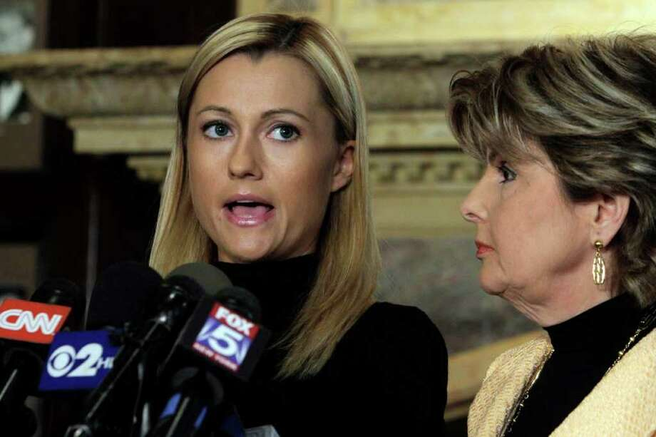 Former porn actress Ginger Lee, left, reads a prepared statement  as her attorney Gloria Allred listens during a news conference at the Friars Club, in New York,  Wednesday, June 15, 2011. Lee, who said she exchanged emails and messages over Twitter with New York Rep. Anthony Weiner, said Wednesday that he asked her to lie about their online communications. (AP Photo/Richard Drew) Photo: Richard Drew