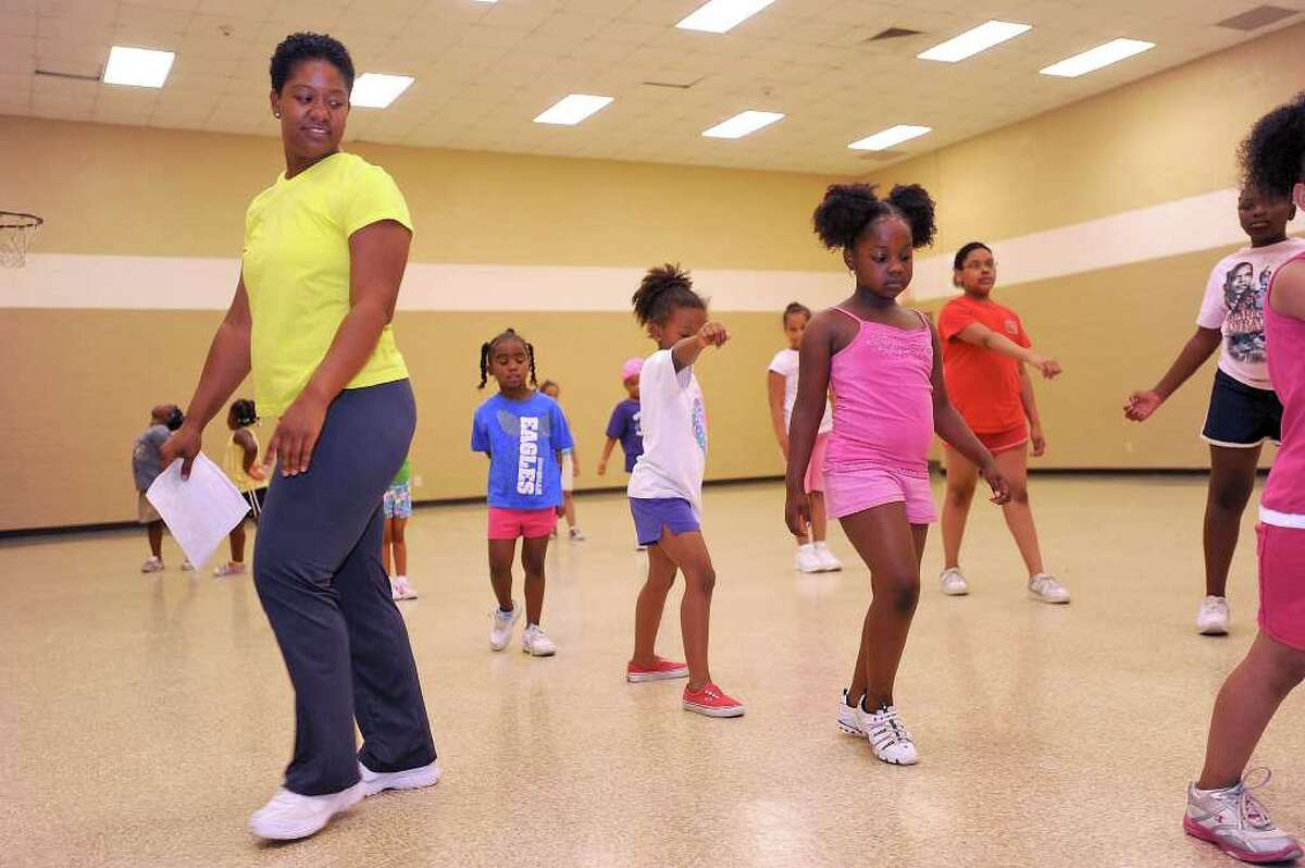 Kim Anderson instructs a cheerleading class for young girls at the L.L. Melton Family Life Center. Guiseppe Barranco/The Enterprise