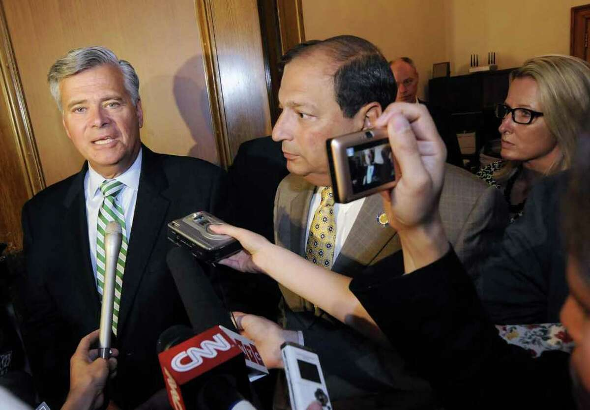 After a lengthy meeting with other republican senators Senate Majority Leader Dean Skelos,left, and Sen. Tom Libous speak to the media at the Capitol in Albany, NY June 15, 2011.( Michael P. Farrell/Times Union )