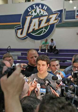 Jimmer Fredette, center, talks to the media after a pre-draft workout for the Utah Jazz NBA basketball team, Wednesday, June 15, 2011, in Salt Lake City.  (AP Photo/Deseret News, Tom Smart) SALT LAKE OUT, PROVO OUT, MAGS OUT Photo: Tom Smart
