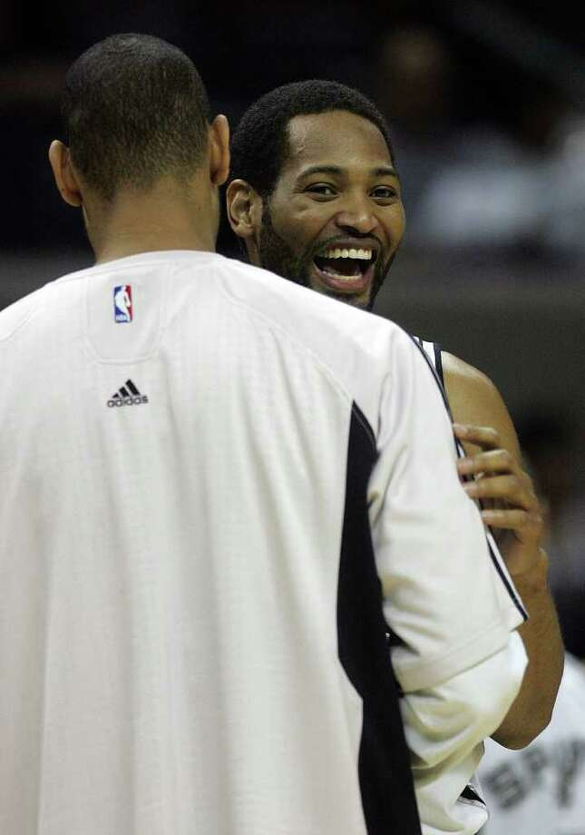 SPORTS - Robert Horry is hugged by Tim Duncan near the end of the game in the second half of game four of their Western Conference semifinals series Sunday, May 11, 2008 at the AT&T Center. Horry tied the record for most playoff games played. The Spurs won 100-80. BAHRAM MARK SOBHANI/msobhani@express-news.net Photo: BAHRAM MARK SOBHANI, Express-News / msobhani@express-news.net