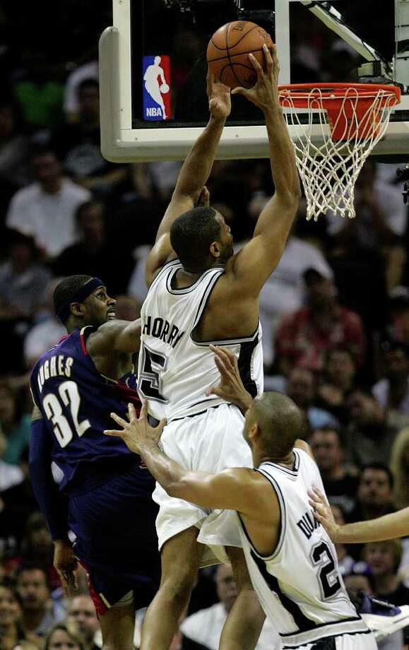 Spurs' forward Robert Horry (5) beats Cleveland Cavaliers guard Larry Hughes (32) to the rebound during first half action in the NBA Finals game two in San Antonio Sunday June 10, 2007.  (BAHRAM MARK SOBHANI/STAFF) Photo: BAHRAM MARK SOBHANI, Express-News / SAN ANTONIO EXPRESS-NEWS
